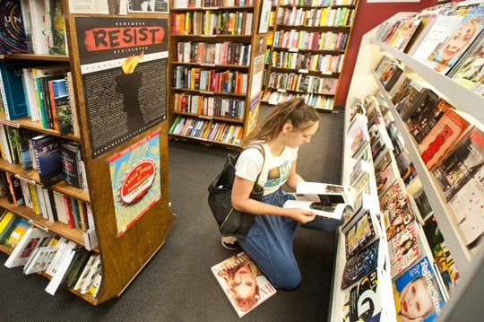 Emma Baird of St. Matthews looks through a magazine at  Carmichael's Bookstore on Frankfort Ave. in Crescent Hill.