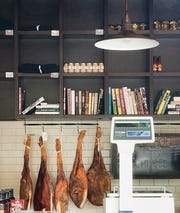 Cured meats hang in The Red Hog on Frankfort Avenue.