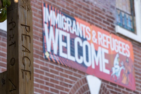 Banners were on display welcoming immigrants and refugees at St. William Catholic Church on West Oak Street as it announced it would now be a sanctuary church. Oct. 8, 2019
