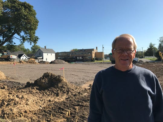 Terry Conard, director of Friendly House, stands outside the facility's new parking lot along Springmill and Mulberry streets, paid for by anonymous donors.