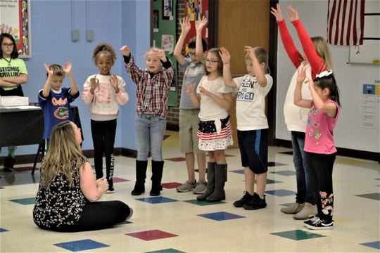 "Members of the George Washington Elementary School choir sing during the Marion City Schools state of the schools meeting on Monday. The students sang ""This Land is Your Land,"" led by director Bethany Stang. Students in the choir are Laurynn Harrison, Lyrik Mullins, Brady Kelly, Lexi Kress, Kobain Smith, Annabel Estep, and E'liana Emptage-Faggs."