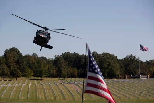 A Blackhawk helicopter tilts back and forth Tuesday, Oct. 8, 2019, during an internment service for Maj. Trevor Joseph at West Tennessee State Veterans Cemetery in Memphis. Joseph died in an aviation accident at Fort Polk, Louisiana.