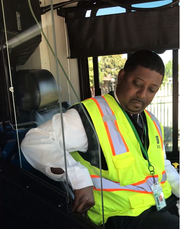 Marcus Davis, a training supervisor for MATA, demonstrates the bus operator shiedl