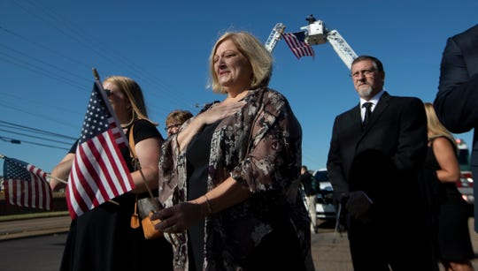 Peggy Salentine, of Collierville, puts her hand over her heart as the hearse carrying Maj. Trevor Joseph passes by Tuesday, Oct. 8, 2019, before his funeral service at Harvest Church in Germantown. Joseph died in an aviation accident at Fort Polk, Louisiana.