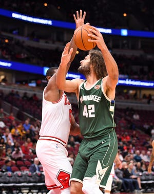 Oct 7, 2019; Chicago, IL, USA;  Milwaukee Bucks center Robin Lopez (42) shoots the ball over Chicago Bulls forward Cristiano Felicio (6) during the first half at the United Center.