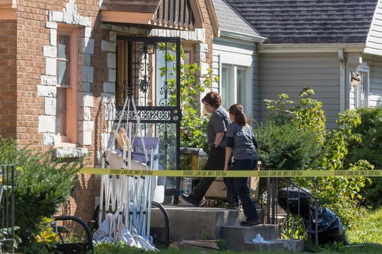 Law enforcement personnel gather outside a possible crime scene Tuesday, in the 4600 block of North 24th Place in Milwaukee.