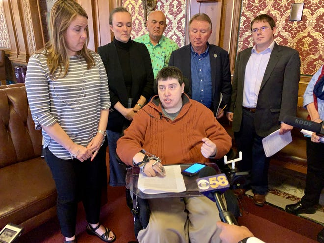 Democratic Rep. Jimmy Anderson of Fitchburg, center, and other Democratic Assembly members speak to reporters after Assembly Speaker Robin Vos released a new rule change allowing Anderson to call into meetings.