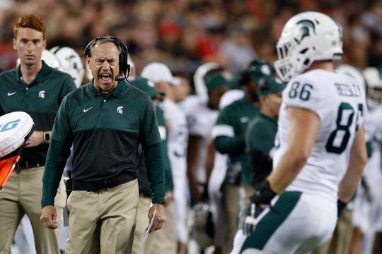 Michigan State coach Mark Dantonio shout to a player during the first half of the team's NCAA college football game against Ohio State on Saturday, Oct. 5, 2019, in Columbus, Ohio. (AP Photo/Jay LaPrete) ORG XMIT: OHJL109