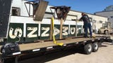 See the Goldmann's Department Store sign loaded onto a truck