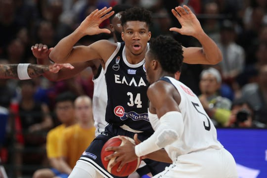 Greece's Giannis Antetokounmpo tries to block United States' Donovan Mitchell during phase two of the FIBA Basketball World Cup at the Shenzhen Bay Sports Center in Shenzhen in southern China's Guangdong province.