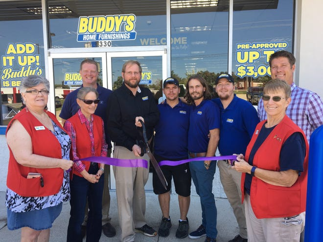 The Mountain Home Area Chamber of Commerce recently held a ribbon cutting at Buddy's Home Furnishings, located at 330 Highway 62 East in Mountain Home, to celebrate their newly remodeled store and entirely new staff. Store Manager Dan Wright says Buddy's has a price-match guarantee, in which they will meet or beat any other rent-to-own area competitor's price. Buddy's also services the products they sell, offering replacement products until the repair is complete. For those who haven't yet established credit, Buddy's has a no credit check policy and rent-to-own options. Temporary rentals are also available for businesses such as realtors needing to stage a home or for that customer who wants a gigantic screen television for the big game. Delivery and set up are always free. For more information visit their Facebook page or call (870) 425-3999.