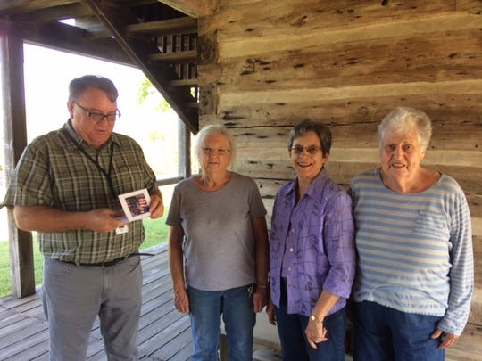 Members of the United Daughters of the Confederacy Caroline Meriwether Goodlett Chapter #2644 of Mountain Home recently toured the Jacob Wolf House in Norfork. Pictured are members with Marlon Mowdy,Historic Site Managerat the Wolf House. Not pictured: Dianne Freeman.
