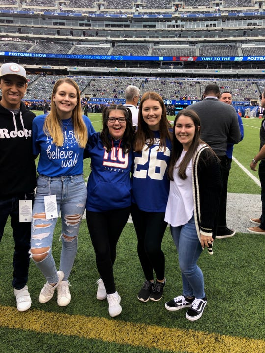 Erika Morgan, 18, of Rockaway Township got to go on the field at MetLife Stadium before the Giants-Vikings game on Sunday.