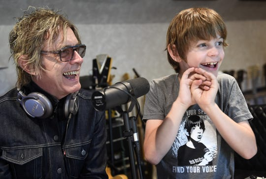 Tom Petersson and his son, Liam, enjoy some time in their home recording studio.