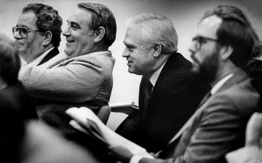 "Undercover FBI Special Agent Ken Walsh, right, sits in a Senate hearing room Feb. 29, 1988 next to lobbyist David ""Peabody"" Ledford, left, bingo figure W.D. ""Donnie"" Walker and Secretary of State Gentry Crowell."