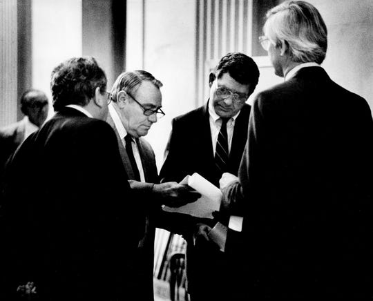 "Bingo lobbyist W.D. ""Donnie"" Walker, second from left, discusses proposed amendments to bingo reform legislation with the bill's sponsor, Sen. Frank Lashlee, second from right, D-Camden, outside the Senate chambers March 28, 1988 as other bingo lobbyists David ""Peabody"" Ledford and Bill Bruce look on."