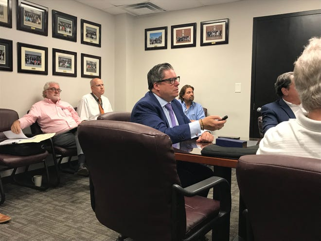 L. Carson Bise, II, president of the consulting firm Tischler Bise, delivered a presentation reviewing the educational impact fee during a county budget committee meeting.