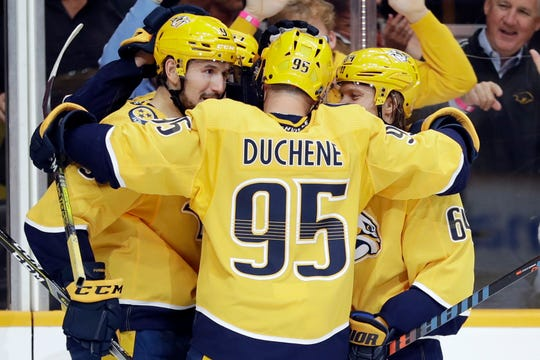 Nashville Predators left wing Filip Forsberg (9), of Sweden, is congratulated by Matt Duchene (95) and Mikael Granlund (64), of Finland, after scoring a goal against the Detroit Red Wings during the second period of an NHL hockey game Saturday, Oct. 5, 2019, in Nashville, Tenn.