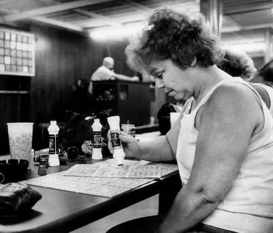 Pat Lester of Crossville, Tenn. joins more than 70 other bingo players in Algood, Tenn. May 25, 1989.
