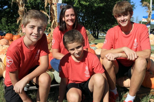 The Cooks, L-R Colby, Cooper, Carson and mom Missy at their Cooper Trooper Pumpkin Patch that raises money to help families who have children diagnosed with childhood Cancer in Cool Springs on Saturday, October 5, 2019.