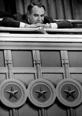 "Bingo lobbyist W.D. ""Donnie"" Walker looks down from the Senate gallery during debate of a massive charity bingo reform package in 1988. The bill passed 23-8 despite a strong lobbying effort against it."