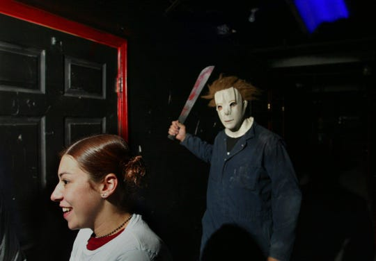 Alana Coleman of Clarksville tries to figure out the correct door to enter as she's pursued by Jason at the Devil's Dungeon, a haunted house in Shelby Bottoms.