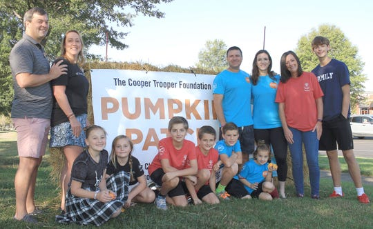 L-R  Chris, Cristin, Olivia and Gwyenth Roark ,Colby and Cooper Cook, Andrew,  Caroline, Mark and Margaret Lantz,  Missy and Carson Cook at the the Copper Trooper Pumpkin Patch in Cool Springs, Tenn. on Saturday, October 5, 2019.