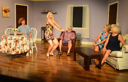 "Marie Prasek, as Verna, gives her new ""business partners"" some imaginations adjustment to become ""Old Ringers."" Seated, left, are  Cindy Hile (Kathy Ann), Ty Szumigala (Harry), Jackie Weiner (Rose) and Kay Wylie-Jacob (Diane)."