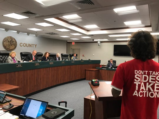 Collier County commissioners hear testimony from speakers as the board weighs a potential ban on the retail sale of cats and dogs in pet stores in Collier on Tuesday, Oct. 8, 2019, at the Collier County Government Center. Some Petland pet store employees wore red shirts in support of the store owner who plans to open a location in Collier.