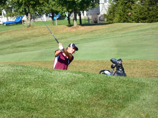 Licking Heights senior Mariana Vega hits an approach shot on No. 7 on Tuesday during the Division I district tournament at New Albany Links. Vega shot a 79 in her final competition for the Hornets.