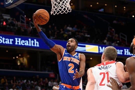 New York Knicks guard Wayne Ellington (2) goes to the basket against Washington Wizards center Moritz Wagner (21) during the first half of an NBA preseason basketball game, Monday, Oct. 7, 2019, in Washington. (AP Photo/Nick Wass)