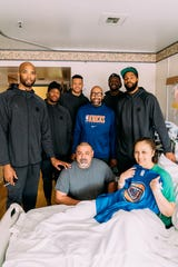 Knicks forward Taj Gibson, guard Dennis Smith Jr., forward Kevin Knox, head coach David Fizdale, forward Julius Randle and forward Marcus Morris visit with a wounded veteran at Walter Reed National Military Medical Center in Maryland on Tuesday.