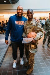 New York Knicks coach David Fizdale with a soldier during the team's visit to the Walter Reed National Military Medical Center on Tuesday.
