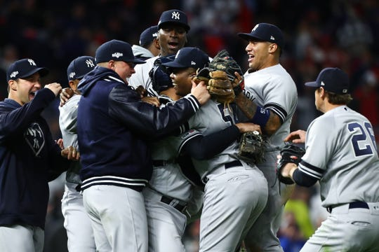 Oct 7, 2019; Minneapolis, MN, USA; New York Yankees players celebrate with relief pitcher Aroldis Chapman (54) after defeating the Minnesota Twins during the ninth inning of game three of the 2019 ALDS playoff baseball series at Target Field. Mandatory Credit: David Berding-USA TODAY Sports