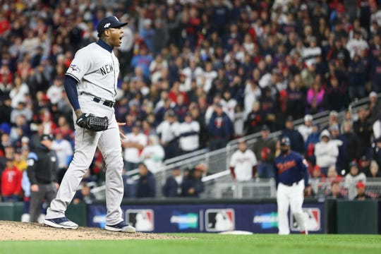 Oct 7, 2019; Minneapolis, MN, USA; New York Yankees relief pitcher Aroldis Chapman (54) reacts to defeating the Minnesota Twins in game three of the 2019 ALDS playoff baseball series at Target Field. Mandatory Credit: Jesse Johnson-USA TODAY Sports