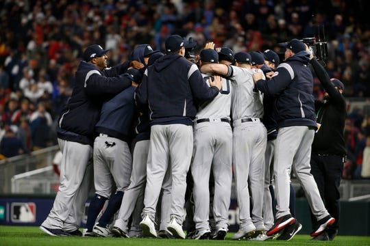 New York Yankees players celebrate after their 5-1 victory over the Minnesota Twins in Game 3 of a baseball American League Division Series, Monday, Oct. 7, 2019, in Minneapolis. (AP Photo/Bruce Kluckhohn)