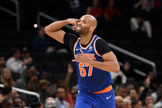 New York Knicks forward Taj Gibson (67) gestures after making a basket during the second half of an NBA preseason basketball game against the Washington Wizards, Monday, Oct. 7, 2019, in Washington. (AP Photo/Nick Wass)