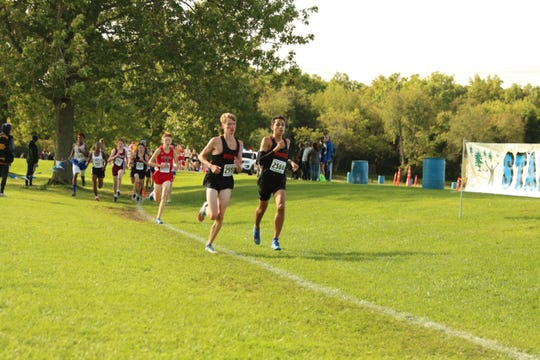 Northville runners Josh Morrisey (left) and Ben Steinig compete at the Wayne County Championship