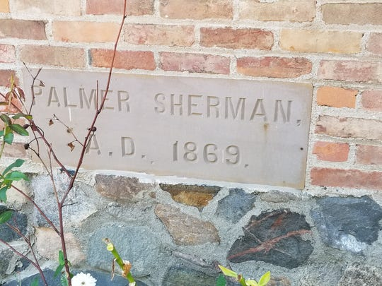 This plaque adorns the 1869 section of the Longacre House, one the home of farmer Palmer Sherman.