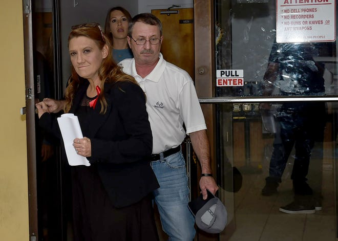 Anthony and Laurie Quebedeaux leave the court annex building Tuesday after Brittany Coupel pleaded guilty to two charges in connection to a wreck that killed their son, Aaron Quebedeaux.