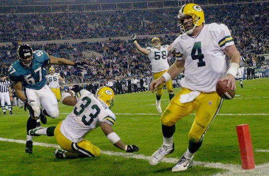 Green Bay Packers quarterback Brett Favre runs in for a touchdown during the closing moments of the fourth quarter of their game against the Jacksonville Jaguars Monday, December 3, 2001 at Alltel Stadium in Jacksonville, Fla.