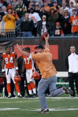 Gregory Gall, 31, runs with the football after taking it from Green Bay Packers quarterback Brett Favre as they play the Cincinnati Bengals in the second half, Sunday, Oct. 30, 2005, in Cincinnati. The Bengals reassessed their security measures in wake of the incident.