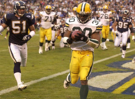 The Packers' Ahman Green snags a touchdown pass from Brett Favre during the fourth quarter of their game against the San Diego Chargers on Dec. 14, 2003, at Qualcomm Stadium in San Diego, Calif.