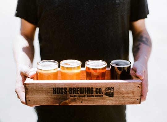 Try many different types of beer with a flight at Huss Brewing Company.