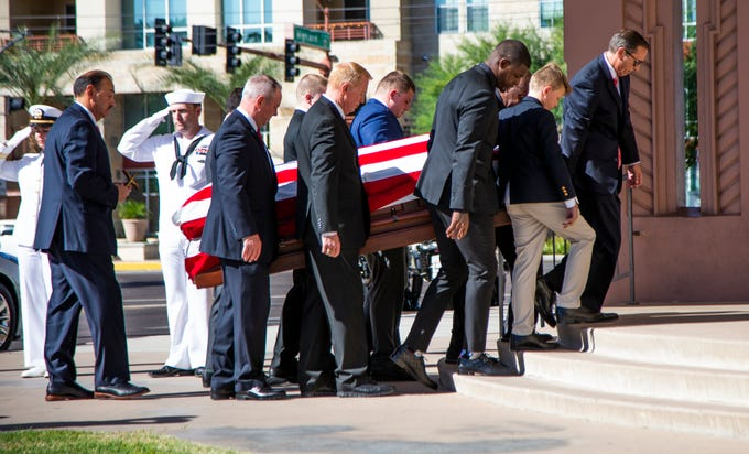 The casket of William Bidwill is carried from the hearse into Saint Francis Xavier Catholic Church for a funeral mass, Tuesday, October 8, 2019. Bidwill, owner of the Arizona Cardinals, died on Wednesday, October 2, 2019.