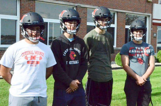 Marine City Cardinal Mooney seniors Paul Nasr, Blake Brown, Ethan Rogus and Richard Marshall wearing their new VICIS helmets on Monday, Oct. 7, 2019.