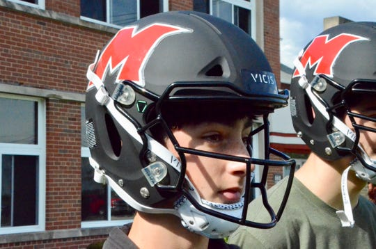 Marine City Cardinal Mooney senior Blake Brown with his new VICIS helmet on Monday, Oct. 7, 2019.