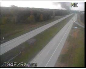Billowing smoke can be seen on Michigan Department of Transportation traffic camera footage near I-94 and Range Road.