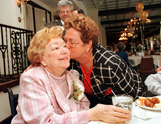 Pat Anger, right, gives a congratulatory kiss to Dorothy Krupp in 1999 at a reception honoring Krupp and other then-community hero and heart of gold award recipients. Anger was then a United Way board member.