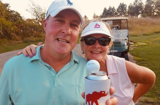 Jon Strathmeyer is shown with his wife, Karen, after getting a hole-in-one on the 290-yard, par-4 fourth hole at Bridgewater Golf Club.